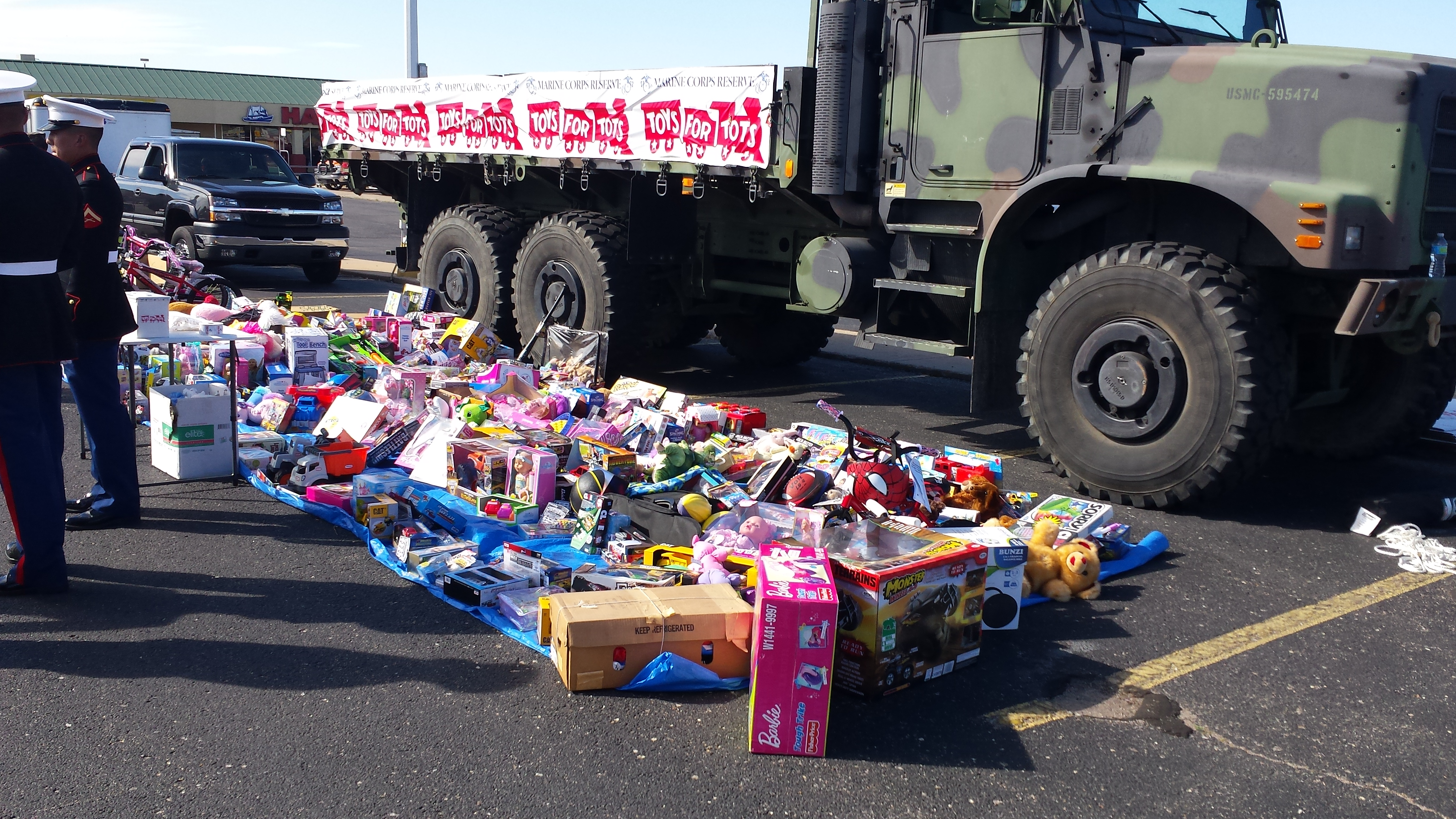 Toys For Tots Drive : Full scale employee helps with toys for tots drive