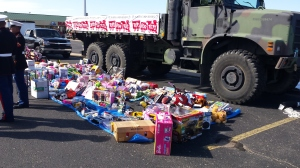 The Kruz'n for Kids drive filled this military truck with donations to Toys for Tots. The truck is 30 feet long, and the tarp is roughly the same length as the truck.