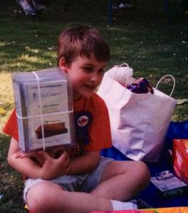 My son at age 7 with his favorite birthday gift, a set of college science lectures on DVD. He needed a STEM mentor but never found one.